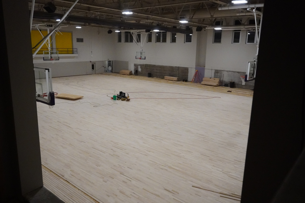 View of the gym floor progress from mezzanine area.
