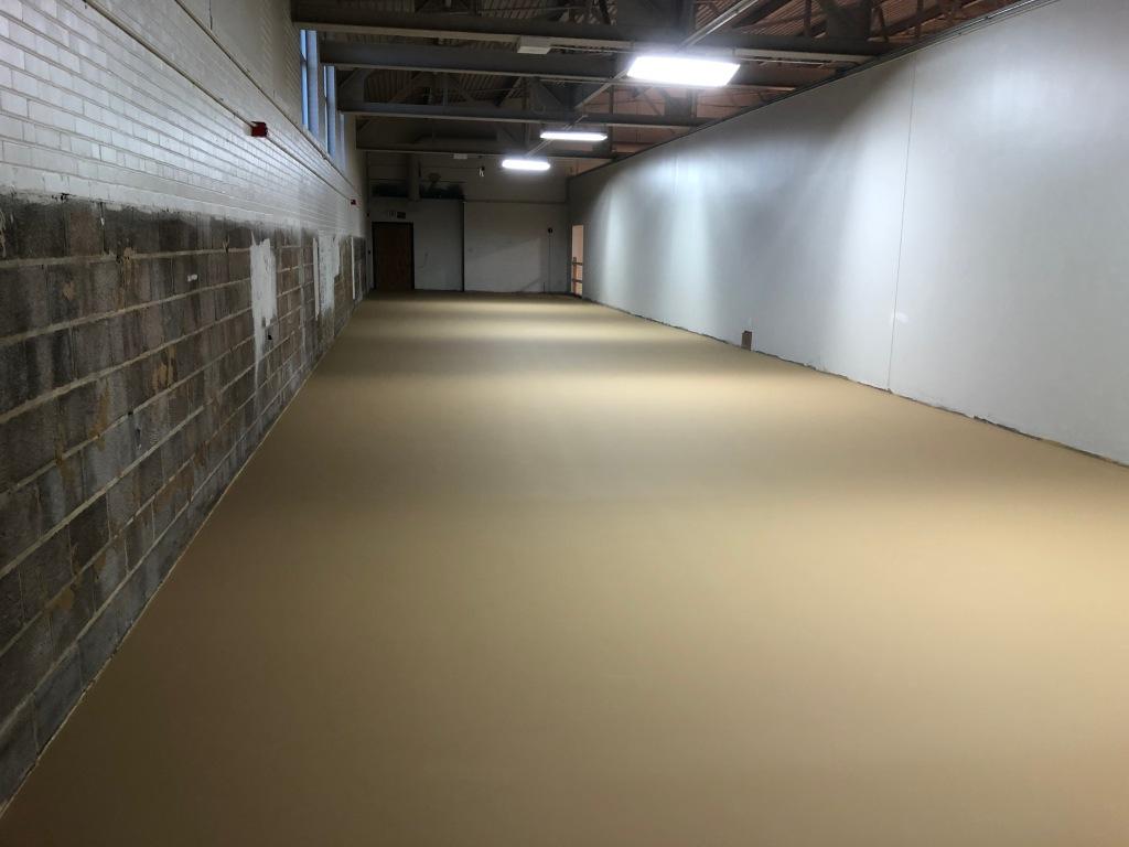 New wrestling room floor provides safe surface for practice.